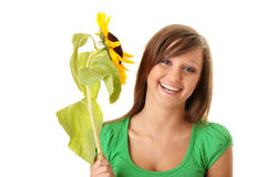 Beautiful teenage girl holding sunflower. Isolated on white background Royalty Free Stock Image