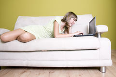 Beautiful teenage girl with laptop Stock Images
