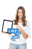 Beautiful teenage girl liking something of social network Royalty Free Stock Photos