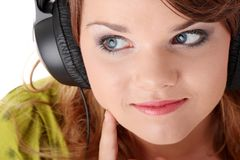 Beautiful teenage girl listening to music Royalty Free Stock Images