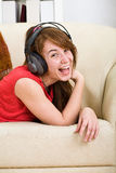 Beautiful teenage girl listening to music Stock Photography