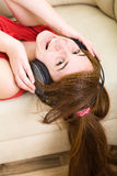 Beautiful teenage girl listening to music Stock Photos