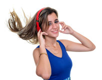 Beautiful teenage girl listening to music on with her hair float Stock Images