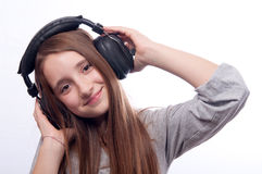 Beautiful teenage girl listens to music Stock Photo