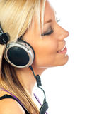 Beautiful teenage girl listens to music Stock Image