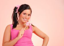 Beautiful teenage girl with a lollipop Royalty Free Stock Photos
