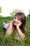 Beautiful teenage girl with long braid in the park Royalty Free Stock Photos