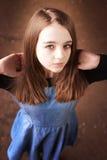 Beautiful teenage girl looking upwards Stock Photo