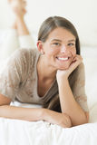 Beautiful Teenage Girl Lying In Bed Stock Images