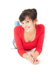 Beautiful teenage girl lying on the floor, smiling Stock Photography