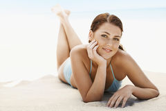 Beautiful Teenage Girl Lying On Sandy Beach Stock Images
