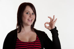 Beautiful teenage girl making OK sign Stock Images