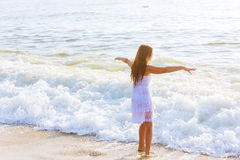beautiful teenage girl on the ocean Royalty Free Stock Photos