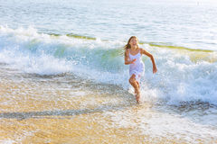 beautiful teenage girl on the ocean Stock Image