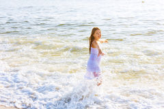 beautiful teenage girl on the ocean Stock Photos