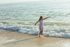 beautiful teenage girl on the ocean Stock Photography