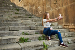 Beautiful Teenage Girl in the Old Town Stock Images