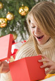 Beautiful teenage girl opening her present Stock Photography