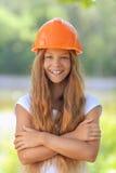 Beautiful teenage girl in an orange Stock Photos