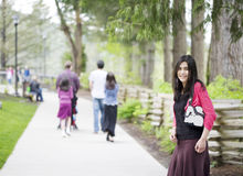 Beautiful teenage girl out on walk with family Royalty Free Stock Photos