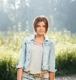 Beautiful teenage girl outdoors. Portrait of beautiful teenage girl outdoors in jeans wear looking at camera Stock Photos