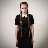 Beautiful Teenage Girl With Plaits Dressed In Black royalty free stock photos