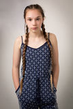 Beautiful Teenage Girl With Plaits and Onesie Stock Images