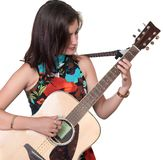 Beautiful teenage girl playing an acoustic guita isolated on white royalty free stock images