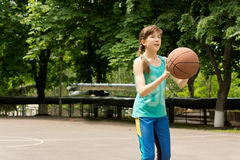 Beautiful teenage girl playing basketball Royalty Free Stock Image