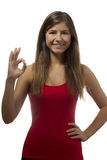 Beautiful teenage girl portrait gesturing ok sign Stock Photo