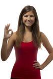 Beautiful teenage girl portrait gesturing ok sign Stock Photo