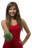 Beautiful teenage girl portrait offering green one apple. One beautiful teenage girl offering one green apple in white background Royalty Free Stock Photos
