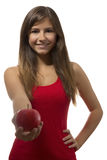 Beautiful teenage girl portrait offering one red apple Royalty Free Stock Photo