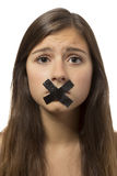 Beautiful teenage girl portrait with taped mouth Royalty Free Stock Photos