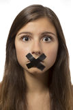 Beautiful teenage girl portrait with taped mouth Stock Photo