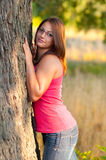 Beautiful teenage girl posing against the tree Royalty Free Stock Image