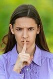 Beautiful teenage girl puts finger Stock Photos