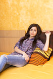 Beautiful teenage girl resting on bed i Royalty Free Stock Images