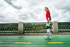 Beautiful teenage girl roller-skating Royalty Free Stock Images