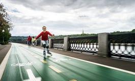 Beautiful teenage girl roller-skating Stock Images