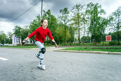 Beautiful teenage girl roller-skating Stock Image