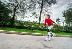 Beautiful teenage girl roller-skating Royalty Free Stock Image