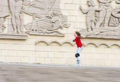 Beautiful teenage girl roller-skating Stock Photo