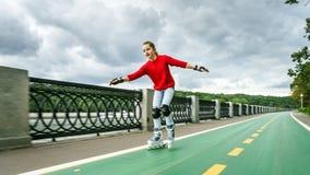 Beautiful teenage girl roller-skating Stock Photos