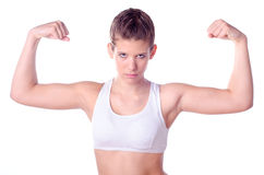 Beautiful teenage girl showing her muscles royalty free stock image