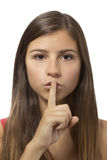 Beautiful teenage girl shushing portrait Stock Images