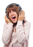 Beautiful teenage girl sings to the music Stock Photography