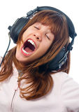 Beautiful teenage girl sings to the music Royalty Free Stock Photography