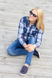 Beautiful teenage girl sitting on wooden floor Royalty Free Stock Photos