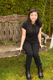 Beautiful Teenage Girl Sitting on Wooden Swing stock image